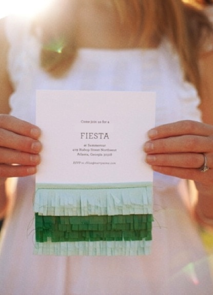 A fun and festive photo of a DIY invitation with fresh colors of green and cream.
