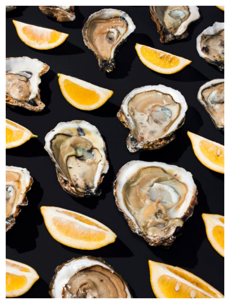 "Nomad Luxuries an inspirational photo of an raw oyster and lemon spread for a ""no cook"" party."
