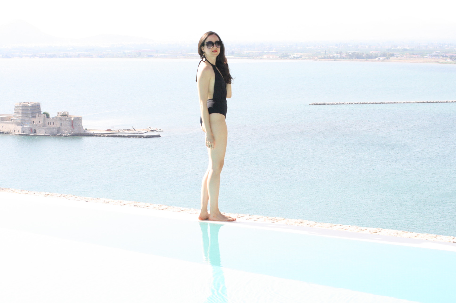 NoMad Luxuries Hotel Greece Black Swimsuit Travel