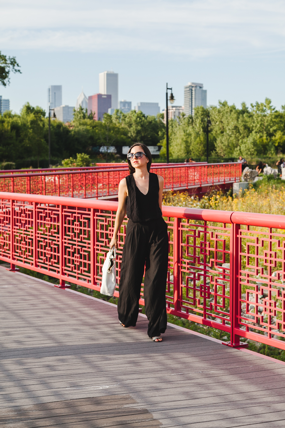 Yana Puaca of NoMad Luxuries wearing an all black pantsuit and ear cuff in Chicago Summer
