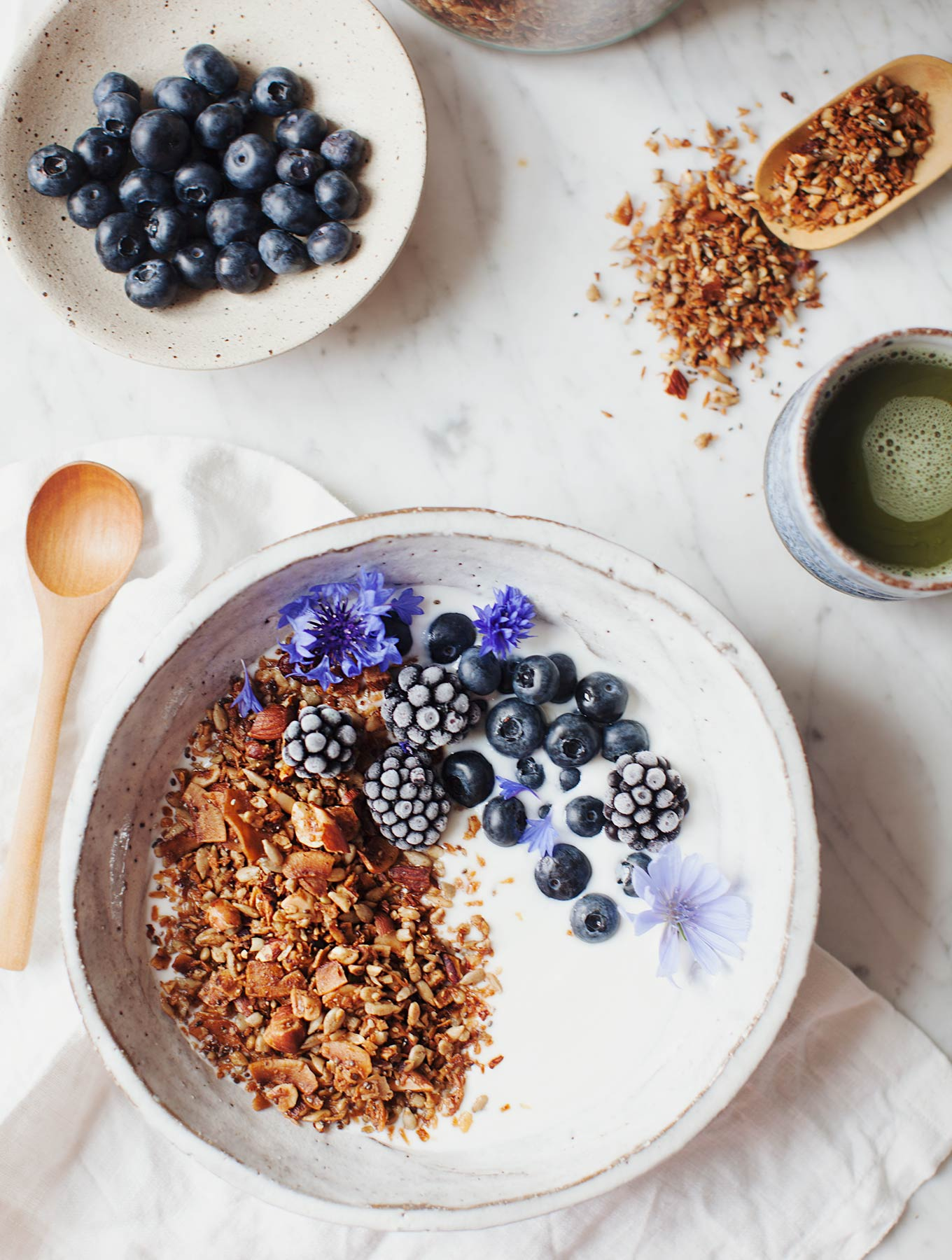 NoMad Luxuries maple cinnamon granola bowl with edible flowers for breakfast and sunday mornings