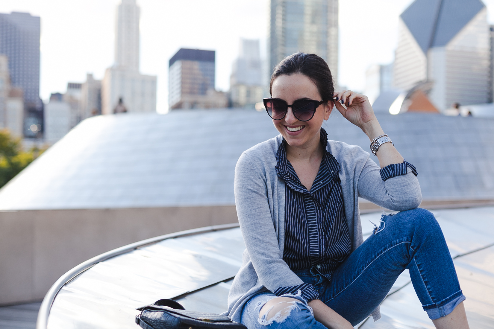 Yana Puaca of NoMad Luxuries wearing a striped shirt and sweater from Banana Republic in Chicago for Fall