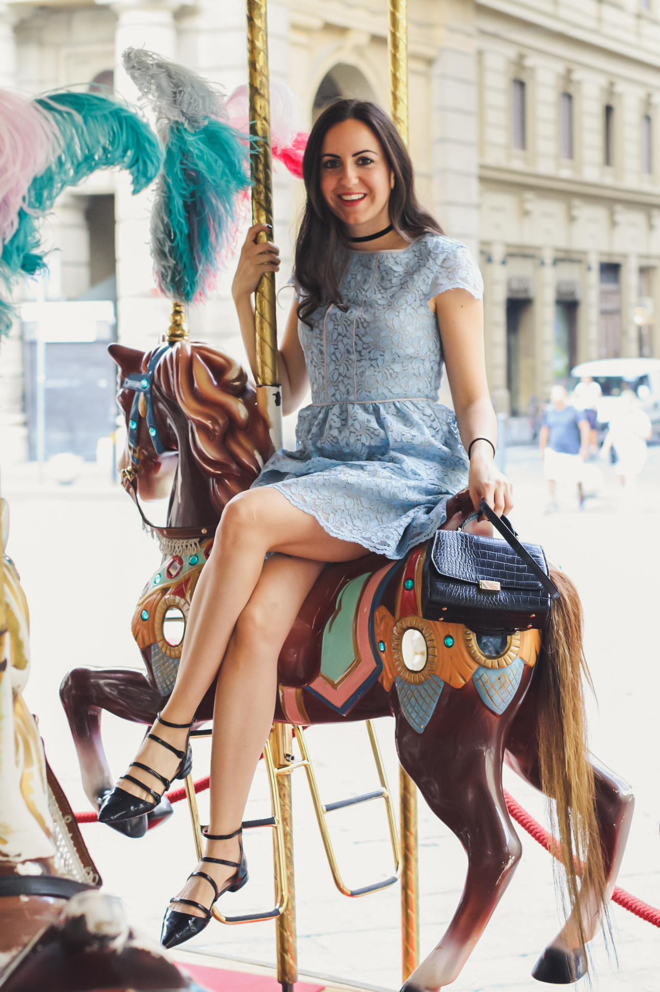 Yana Puaca of NoMad Luxuries wearing a blue lace dress from Banana Republic in Florence, Italy