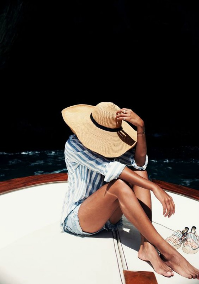 NoMad Luxuries girl in hat on boat weekend reading links