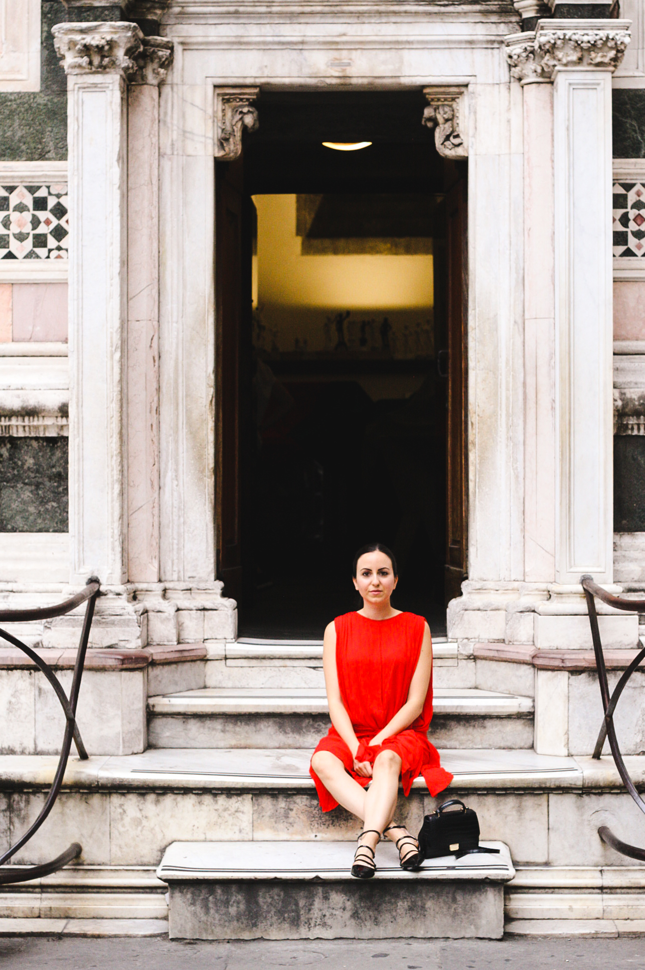 Yana Puaca of NoMad Luxuries wearing a red dress from Asos in Florence, Italy