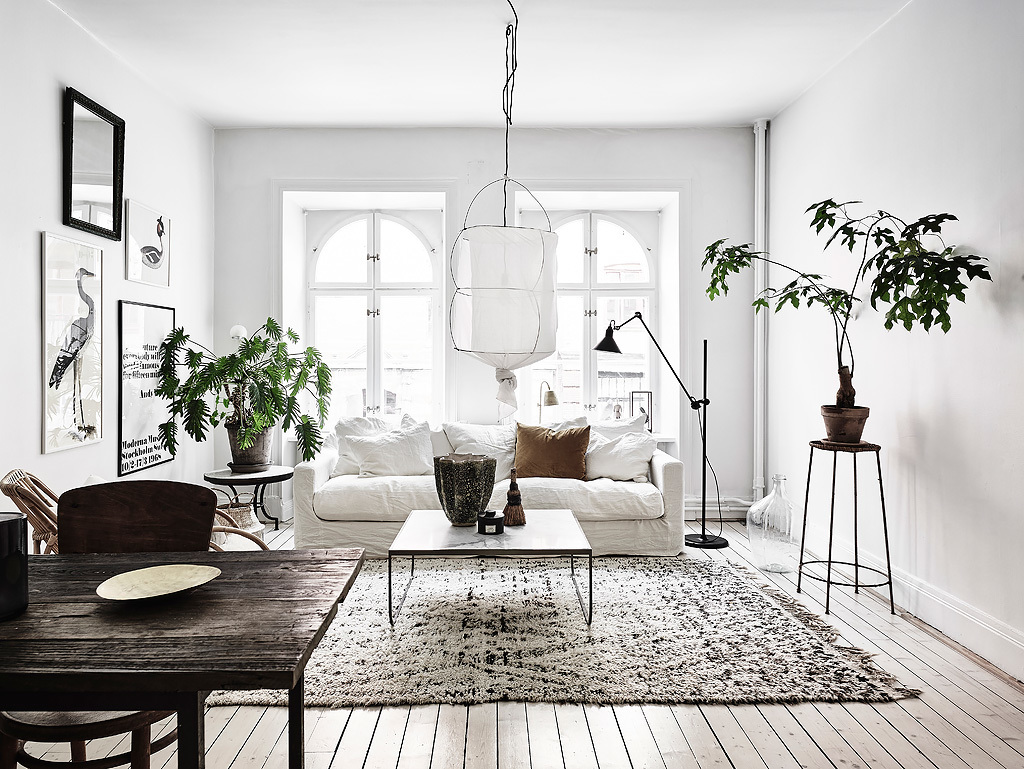 NoMad Luxuries Home Tour Scandinavian design rustic and white washed apartment and a bright living room