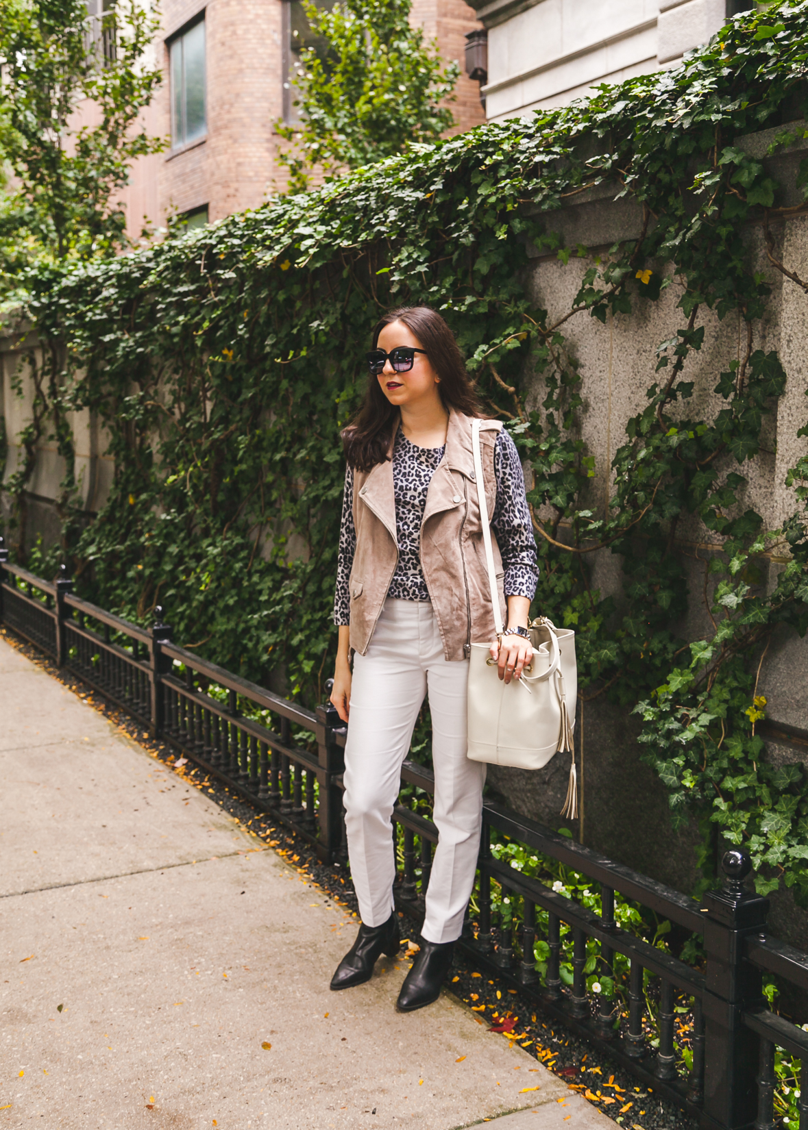 Yana Frigelis of NoMad Luxuries wearing a suede moto vest from TJ Maxx and a cashmere leopard sweater for the Fall in Chicago