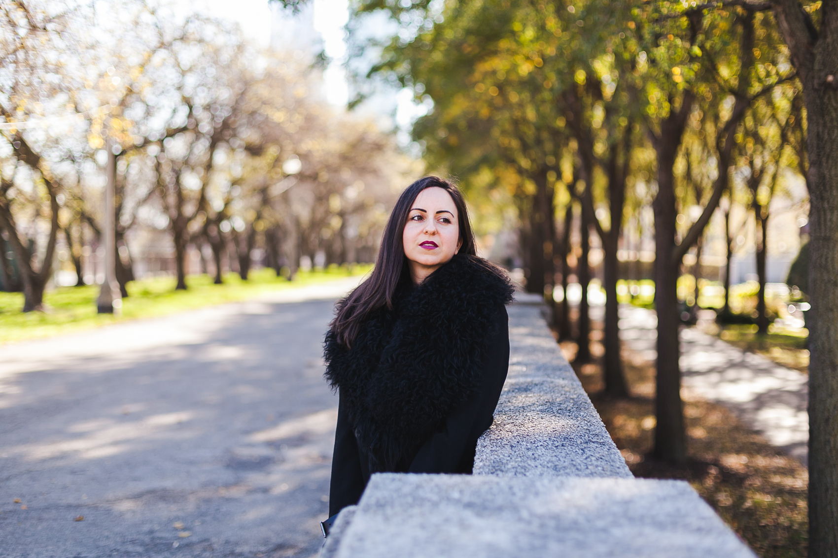 Yana Frigelis of NoMad Luxuries wearing an all black fall look in Chicago