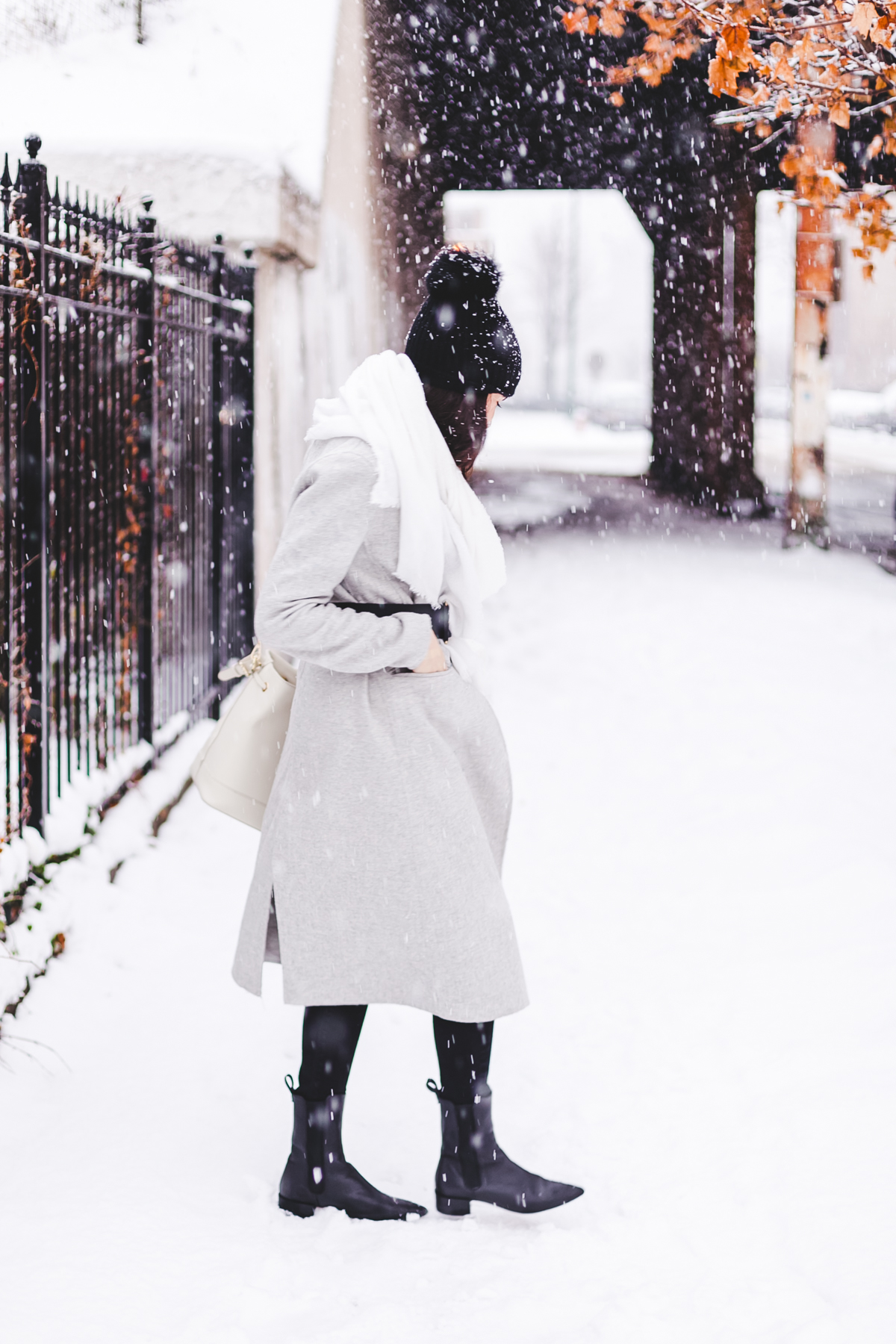 Yana Frigelis of NoMad Luxuries wearinga gray wool coat from zara for winter and new years resolutions