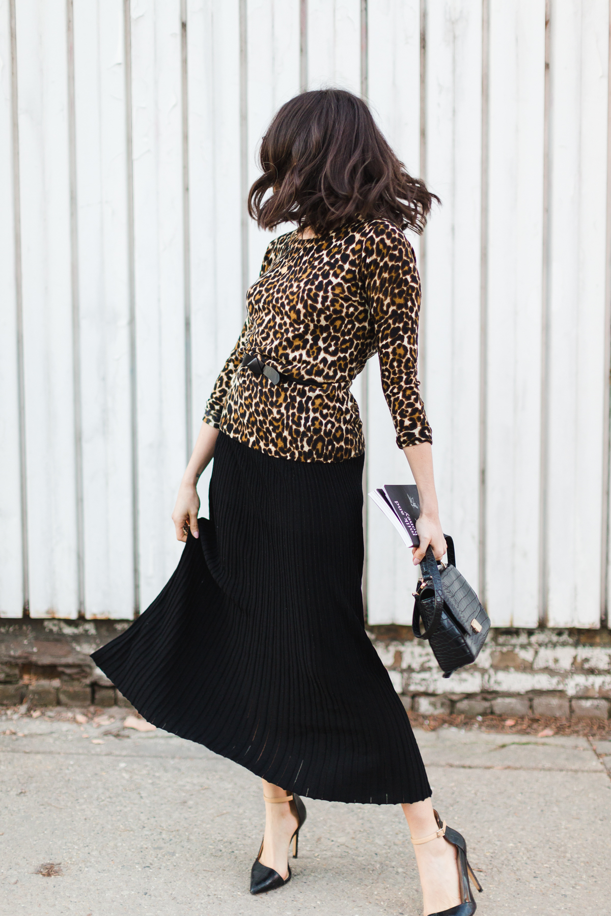 Yana Frigelis of NoMad Luxuries wearing a leopard sweater from Jcrew and a midi length skirt from mango for a classic look