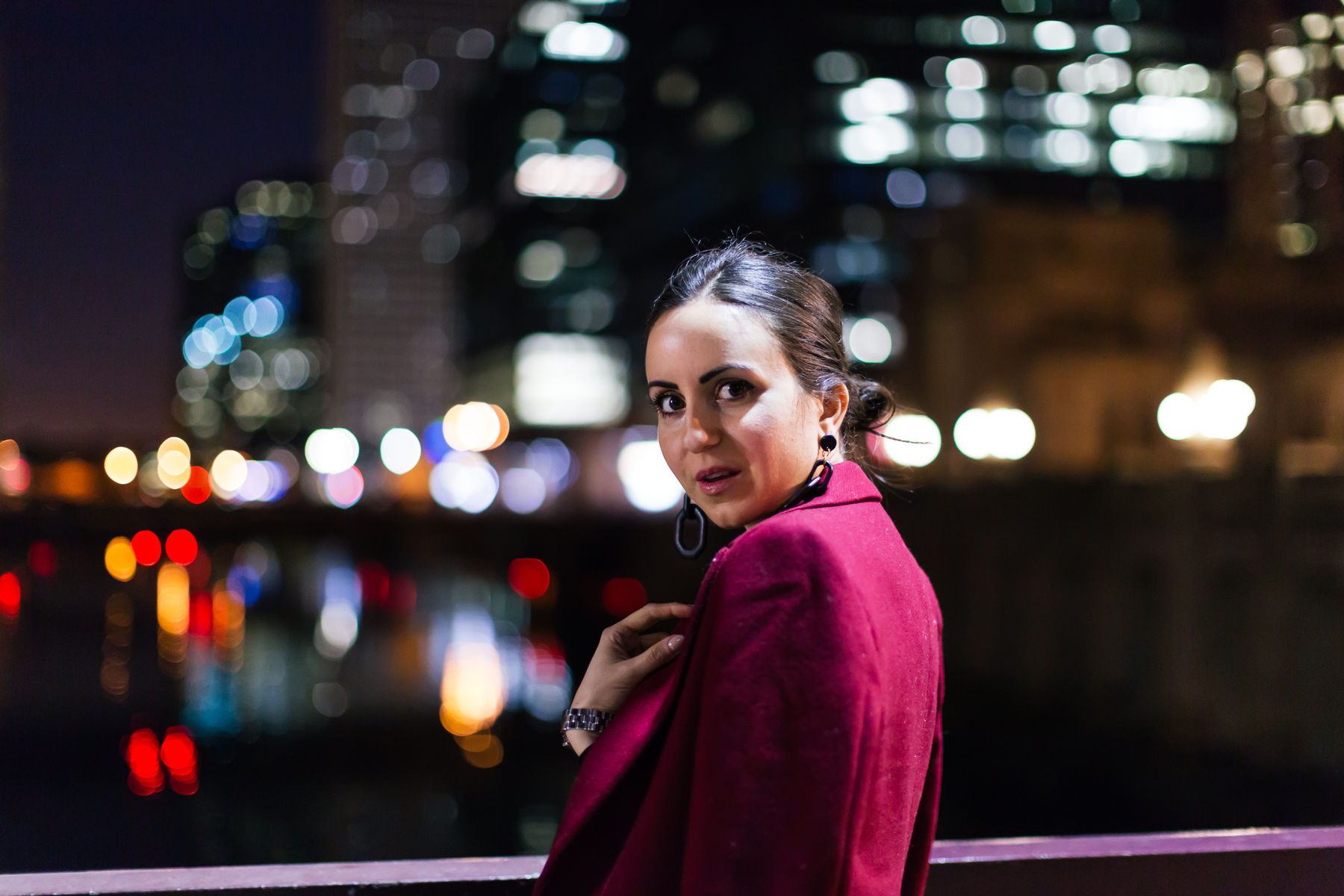 Yana Frigelis of NoMad Luxuries wearing an evening look with a mesh body suit from mango and a red coat from Zara