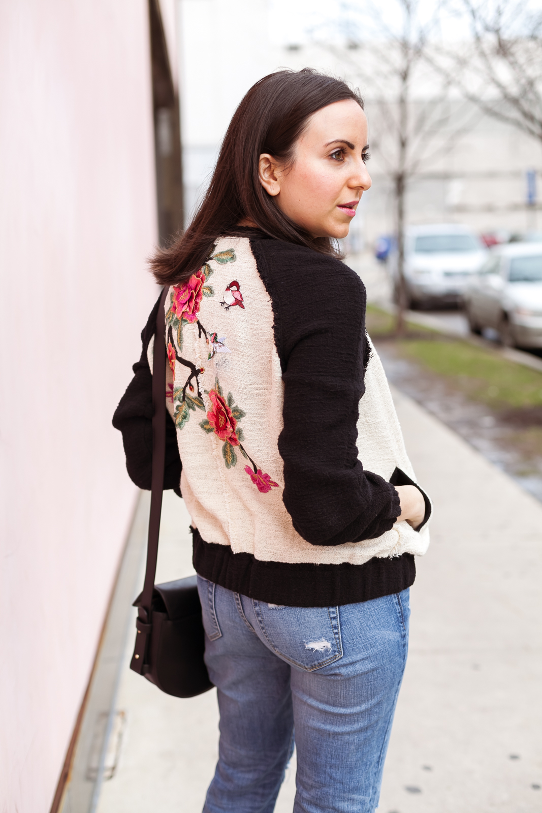Yana of NoMad Luxuries wearing ripped jeans with a floral embroidered jacket from Zara for Spring style in Chicago