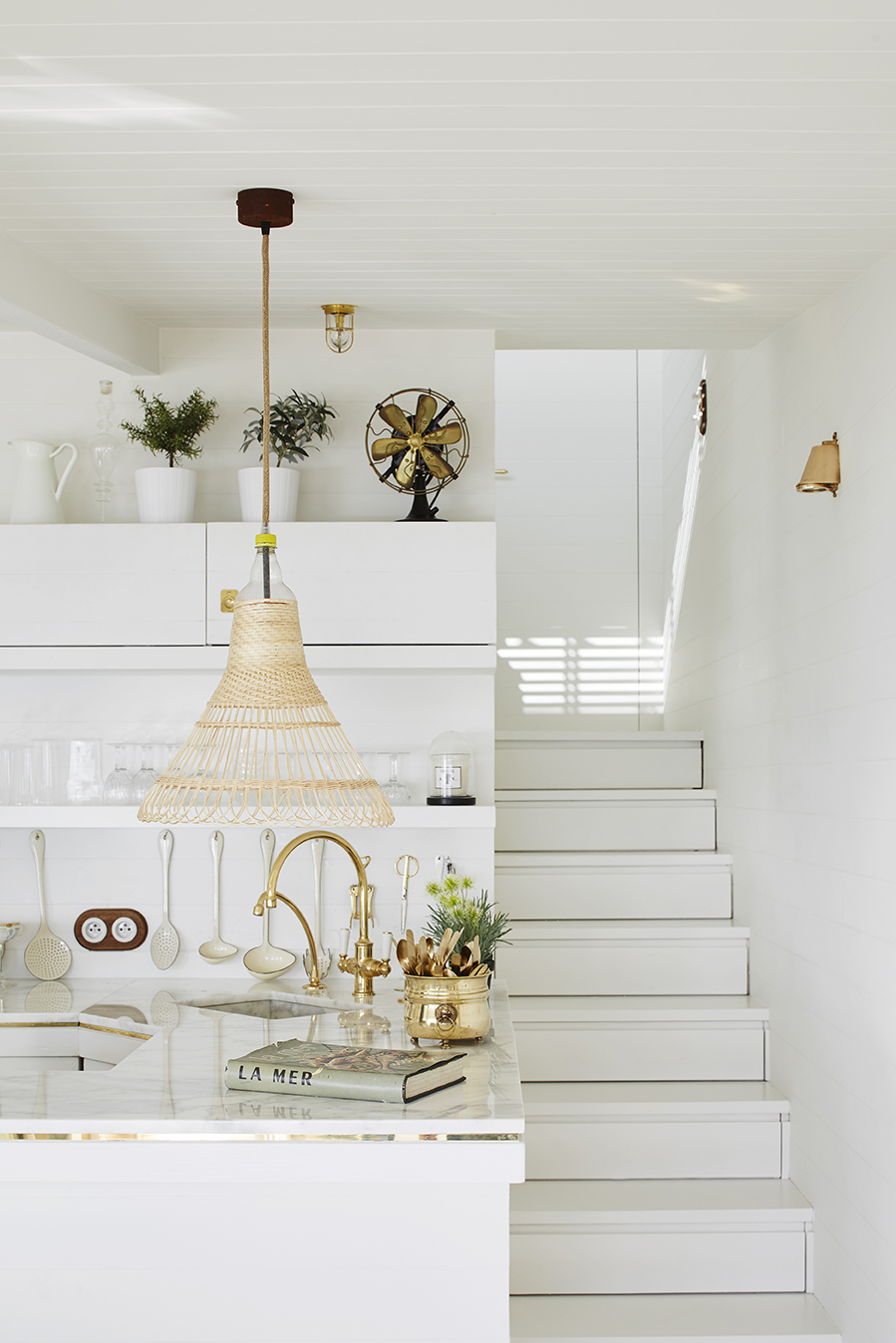 NoMad Luxuries white and bright kitchen with gold accents for sunday pairings