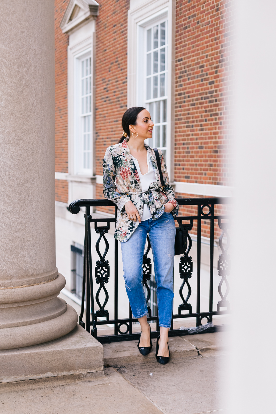Yana Frigelis of NoMad Luxuries wearing a floral blazer from Zara with boyfriends jeans and black accessories for Spring
