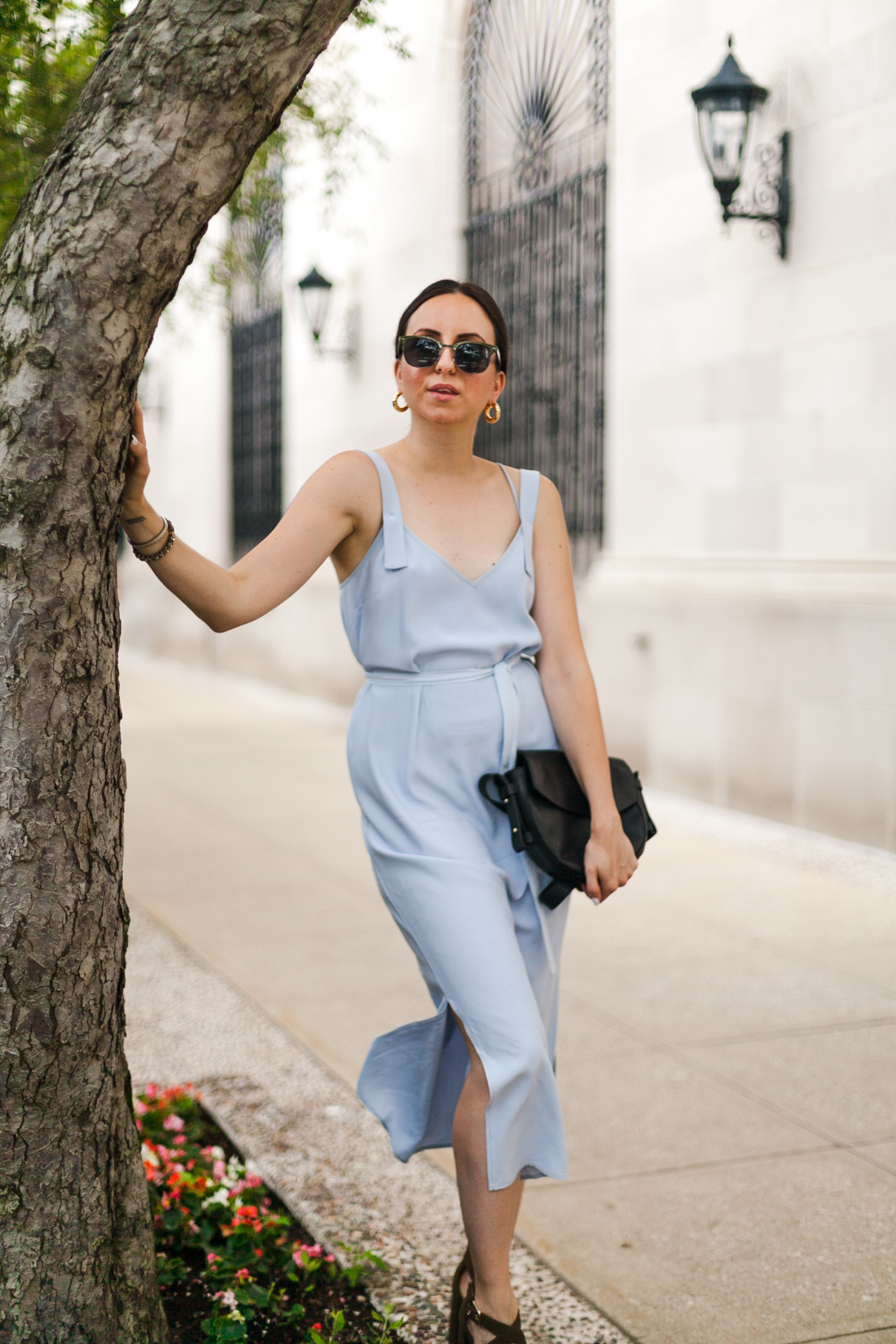 Yana Frigelis of NoMad Luxuries wearing a powder blue topshop dress and olive green suede sandals to an end of summer wedding