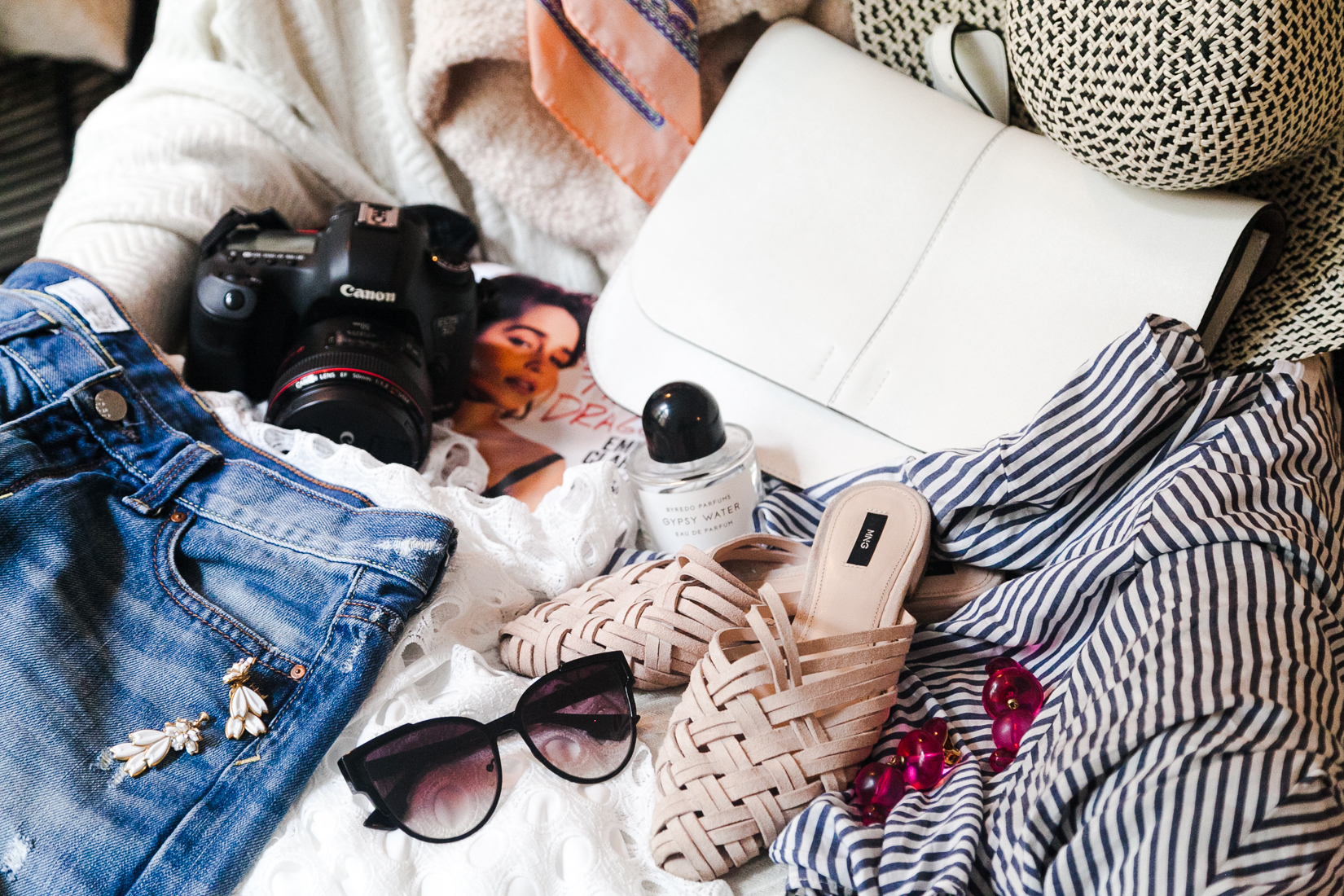 NoMad Luxuries September IT List flatlay beauty, fashion and decor favorites
