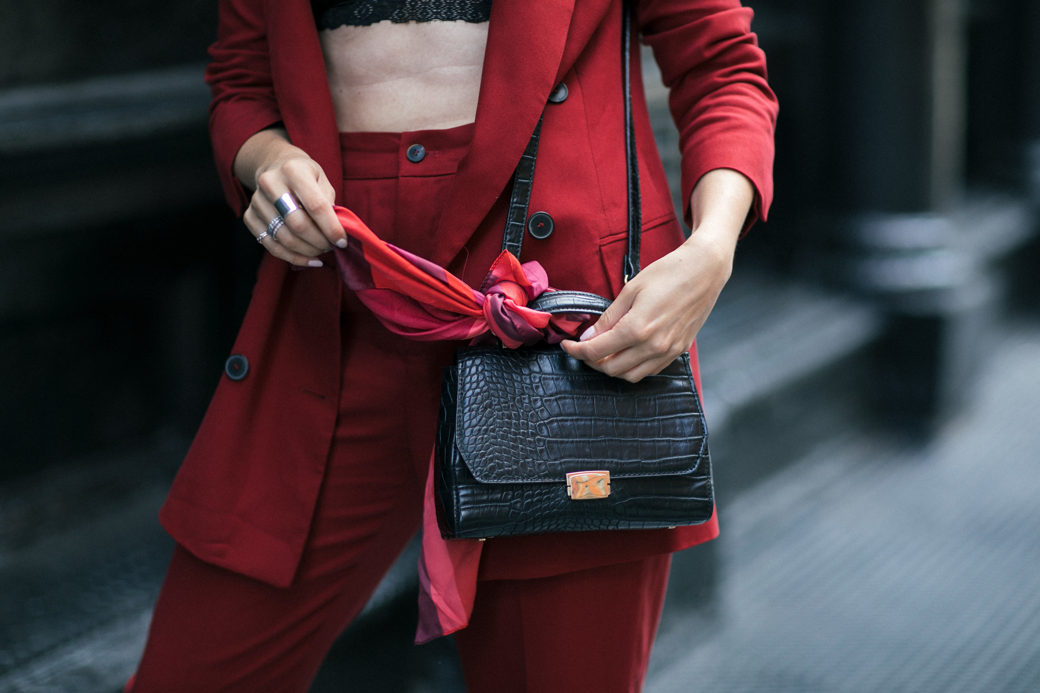 Yana Frigelis of NoMad Luxuries wearing Fall's it color of the season red for new york fashion week in a pant suit from Zara