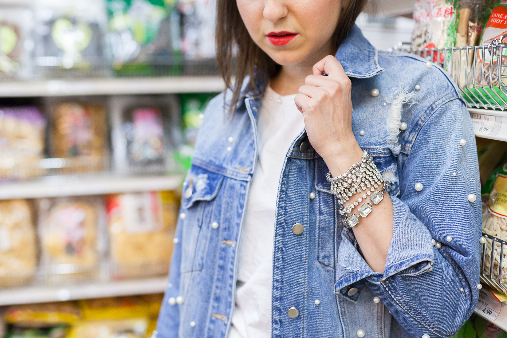Yana Frigelis of NoMad Luxuries wearing a pearl denim jacket from TJ Maxx and the fall trend of pearl embellishments