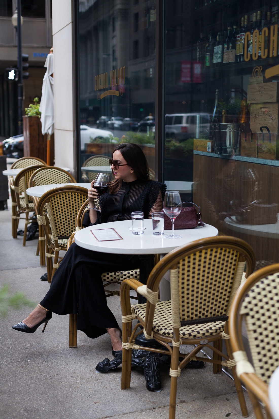 Yana Frigelis of NoMad Luxuries shares how to style a sheer, black lace top with palazzo pants for the Fall