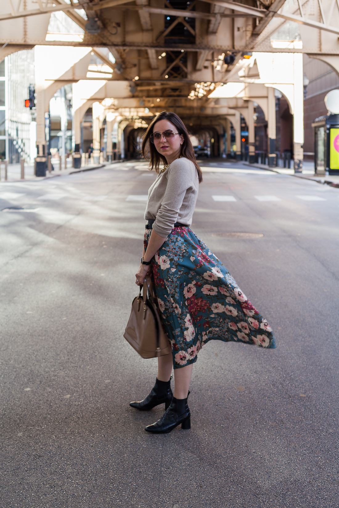 Yana Frigelis of NoMad Luxuries wearing a floral midi skirt with a neutral sweater for a Thanksgiving get together