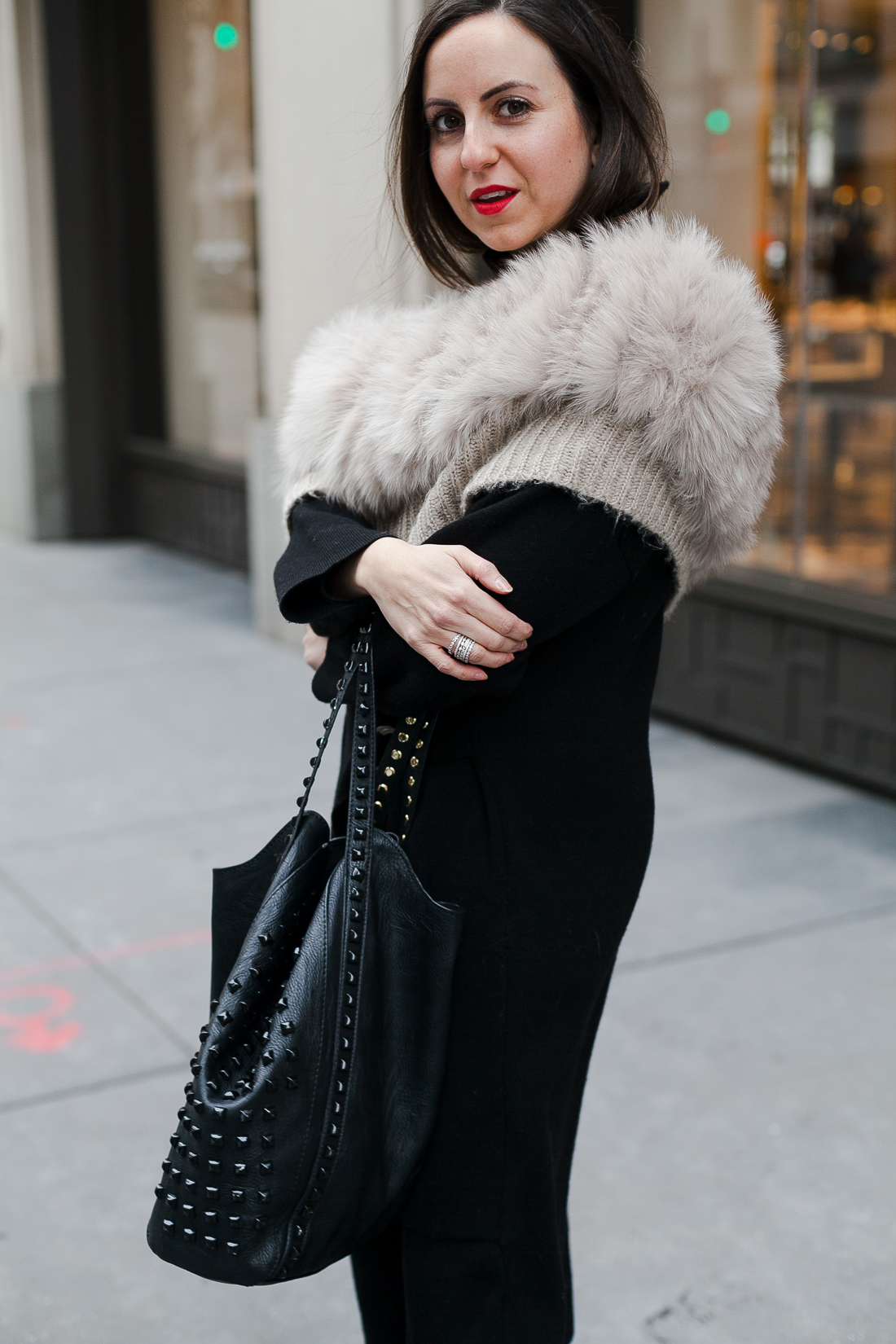 Yana Frigelis of NoMad Luxuries wearing an all black french-inspired look with a fur stole from mango