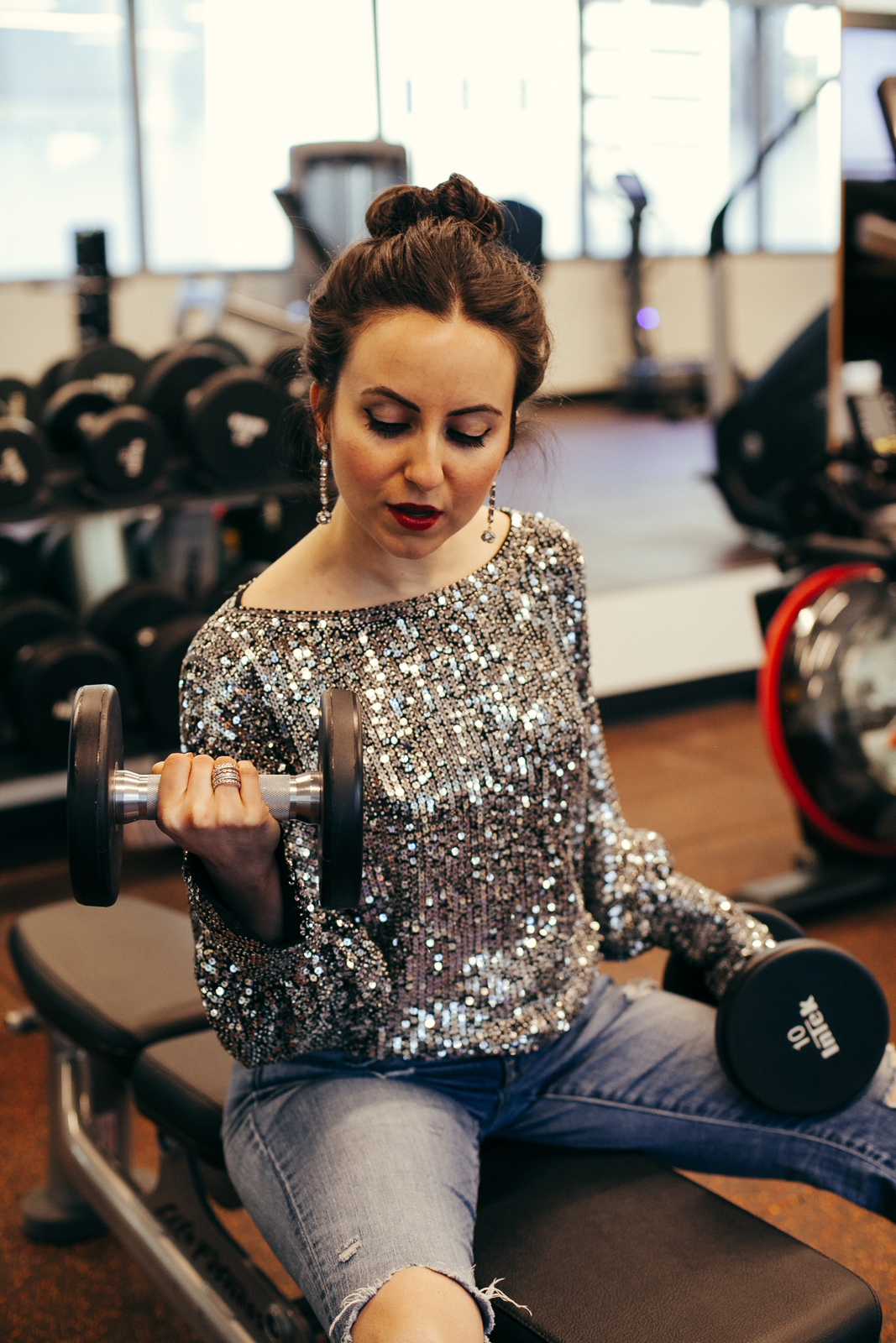 Yana Frigellis of NoMad Luxuries wearing a Trina Turk sequin top for a New Year Mantra in 2018