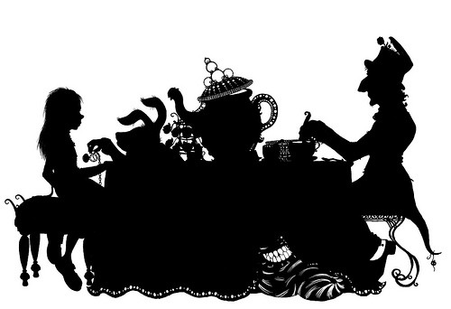 Nomad Luxuries graphic silhouette image of Alice in Wonderland.