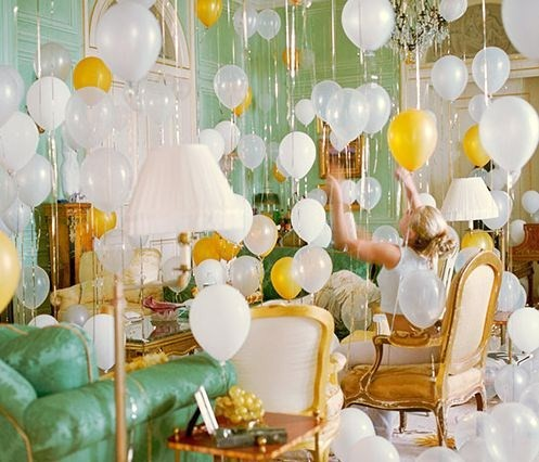 Nomad Luxuries vibrant photo displaying room filled with balloons