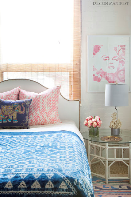 Nomad Luxuries photo of a pastel color themed bedroom with sufficient lighting.