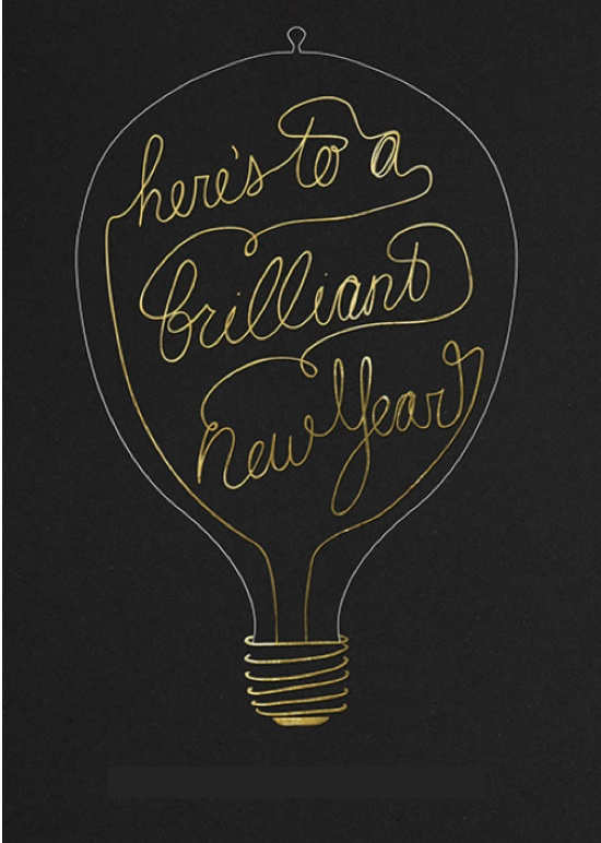 Nomad Luxuries; typographic designed poster in the shape of a light bulb to welcome in the New Year.