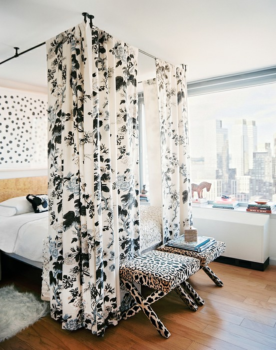 Nomad Luxuries image from Lonny Magazine of a canopy bed with mixed floral prints