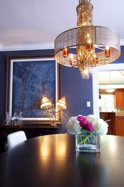 Nomad Luxuries photo of navy and gold themed dining room area.