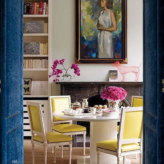 Nomad Luxuries photo inspiration of navy and yellow dining room area.