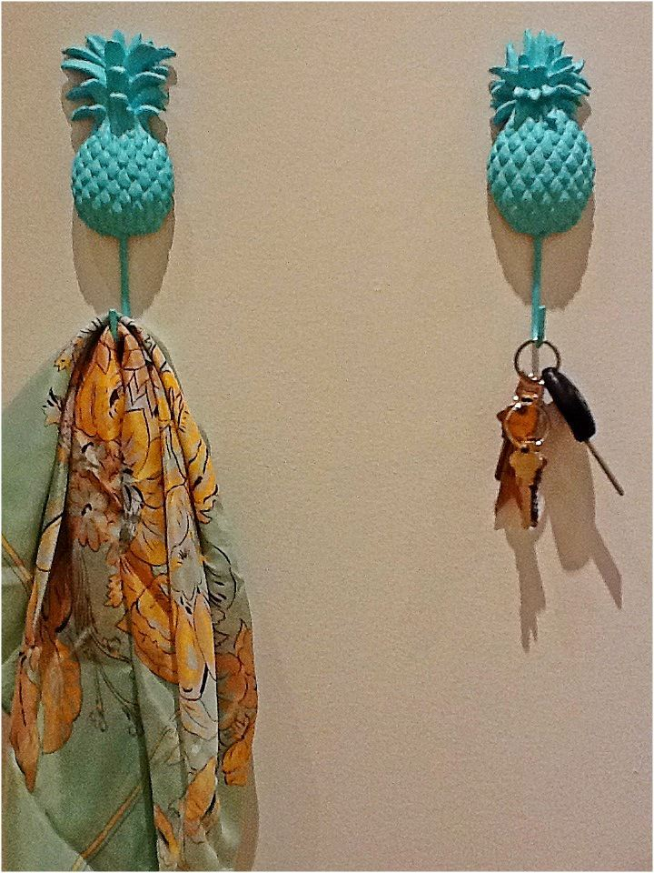 Nomad Luxuries photo of painted pineapple hooks in use.