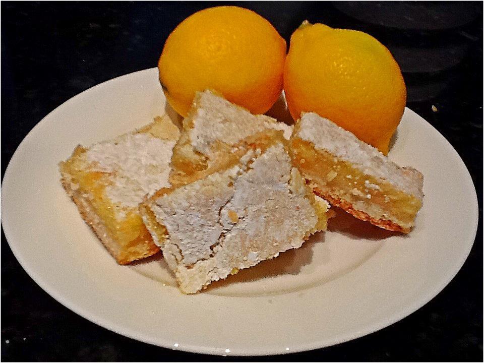 Nomad Luxuries food photo displaying finished lemon bars.