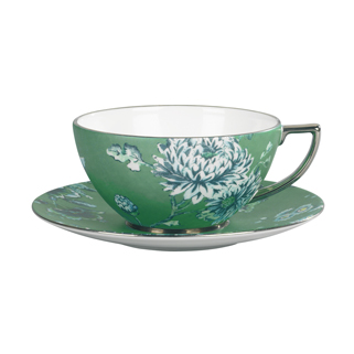 A green tea cup with a floral design to inspire others to grab a healthier choice.