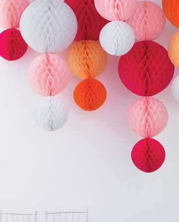 Colorful hanging paper balls for a bright and fun decoration option.