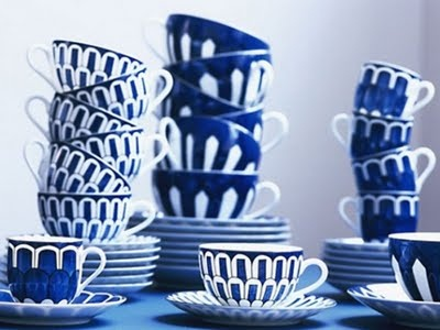 Nomad Luxuries photo of stacked navy blue hermes tea cups.