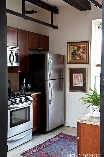 Nomad Luxuries photo of modern kitchen with patterns and wall decor as accents.