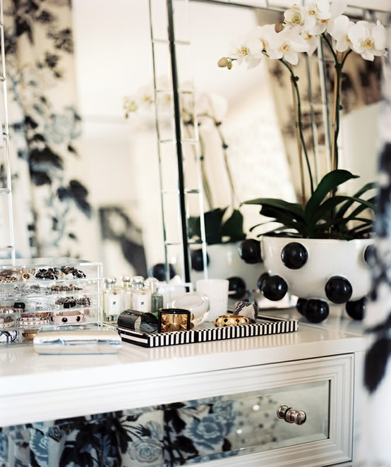 Nomad Luxuries photo via Lonny Magazine of black and white themed vanity.
