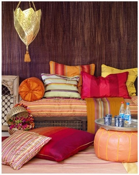 Persian pillows placed strategically to bring a pop of color to brighten up the decor.
