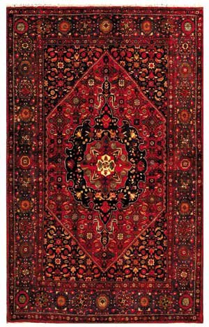 Nomad Luxuries image of decorative red Persian rug for decorative purposes.