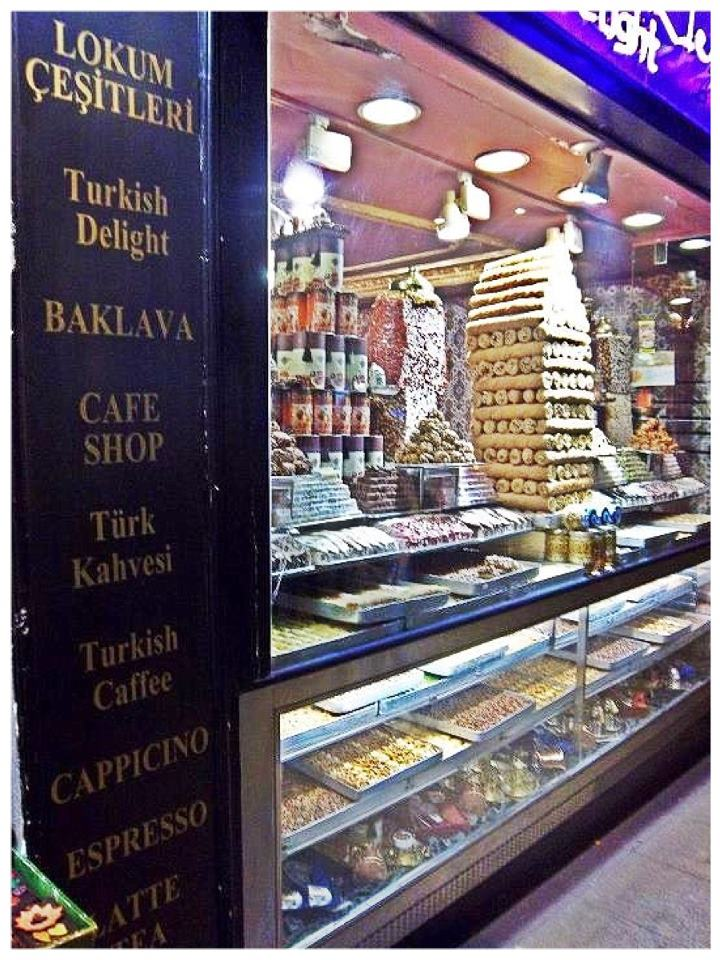 Nomad Luxuries outside view of Turkish sweets displayed in marketplace.