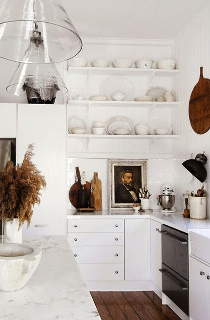 Nomad Luxuries modern white kitchen with organized and clean