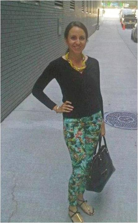 Nomad Luxuries Yana's outfit of the day with brightly patterned pants paired with a neutral top